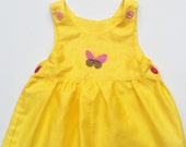 Baby Dress Primrose Yellow with summery butterfly design