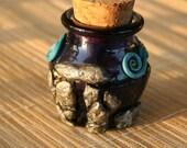 Essence of Bryn Celli Ddu burial chamber polymer clay bottle