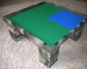 "Play table for LEGO® Bricks with four 10""x10"" regular LEGO Baseplates, Camo color scheme."