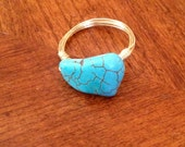 Gold with larger turquoise piece