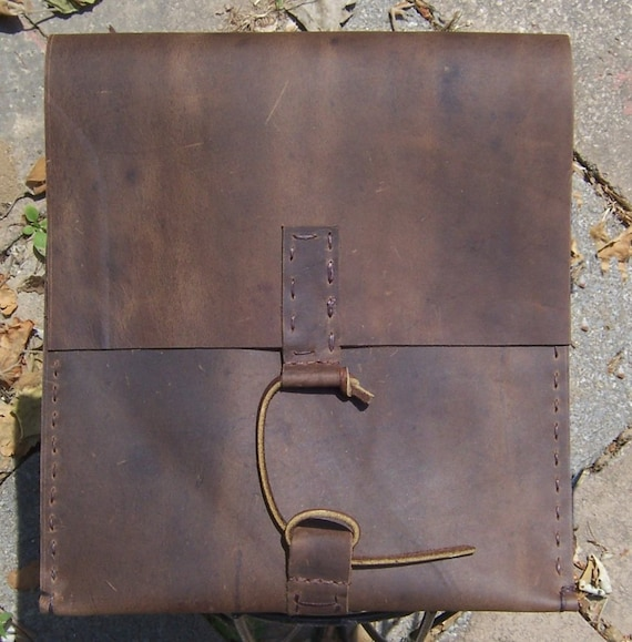 Handmade Leather IPAD Case/envelope (vertical) in Brown with Unique Leather Closure. Hand cut, hand stitched with open Flap holder on back.