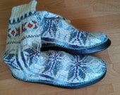 Hand knitted socks with leather sole