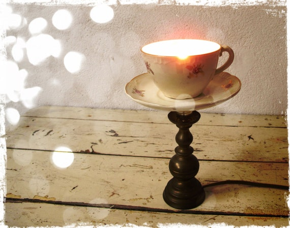 brass lamp with vintage teacup and saucer