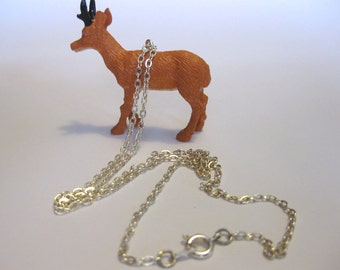 Deer pendant on 18 inch silver plated chain