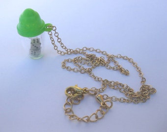 Vintage  dice shaker on 18 inch gold chain.
