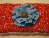 Red diaper wipe case with decorative blue flower