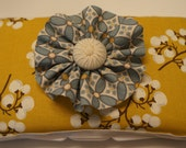 Yellow diaper wipe case with decorative flower