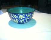 Blue enamle bowl with white and yellow floral design