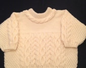 Cream knitted babies cable jumper with cable detail around neck edge  12 months A3