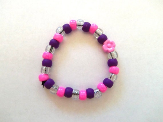 Pink, purple and clear glitter beaded bracelet