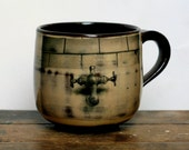 limited edition hand thrown mug with transfer design