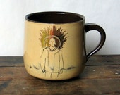 limited edition hand thrown mug with transfer design and gold lustre