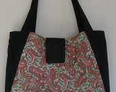 Purse/Tote bag - red paisley with green background.  Black side panels, closure & straps.