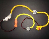 Semiprecious stones hematite and moonstone semi-long necklace with yellow and orange beads