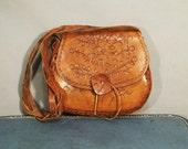 Vintage boho hand-tooled caramel brown leather shoulder bag with leaf & roses design