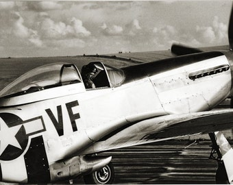 Mustang fighter plane taxiing at air show. Black and white photograph.  Charity item.
