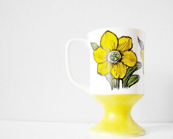 Bright yellow vintage cup with flower illustration pretty retro pedestal mug