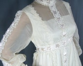 1960s wedding gown with ribbon trim and detachable train