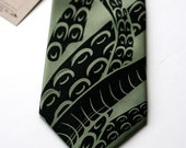 Sucker. Octopus hand silkscreened tentacle necktie. Sage green, choose standard or narrow width.