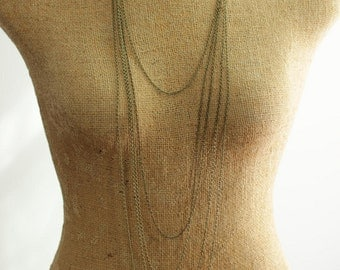 Strand Necklace with Long Multi Layered Chains