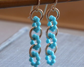 daisy chain earrings (turquoise blue vintage plastic. gold filled wire)