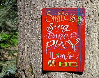 Wall Decor Sign , Smile Laugh Sing Dance Play Love Hug BE