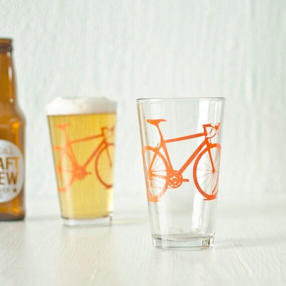 4 bike pint glasses, orange bicycle screen printed glassware