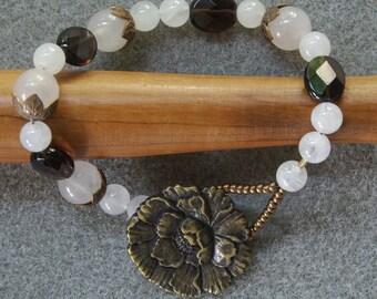 Bronze Blossoms bracelet with brass, smoky quartz, Japanese glass seed beads and rose quartz