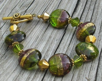 Purple and Olive Lampwork Glass Bracelet, Gold Toggle and Crystals... Colors of Mardi Gras
