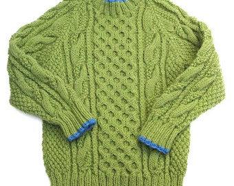 Green Aran Pullover Sweater. Childs Knit Cabled Crew Neck Slipover. Long Sleeve Fisherman Knit Jersey. 2T Green Jumper With Blue Trim