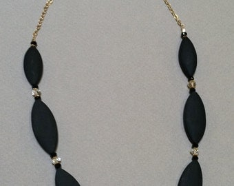 Onyx, Black Garnet and Aquamarine beads with 18k gold beads and heavy 14k gold chain.
