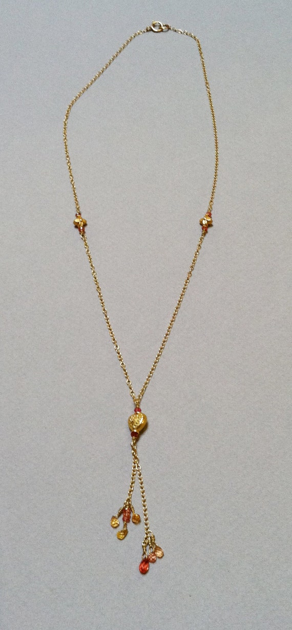 Orange and Yellow Sapphire bead on 18k gold chain with gold beads.
