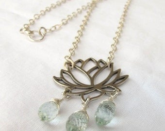 Sterling silver open lotus flower with faceted aqua quartz drops