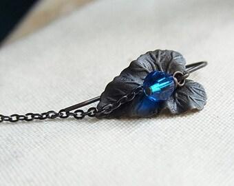 Antiqued Dark Brass Viola Leaf Ear-ring with Capri Blue Crystal // Single Ear-ring // Black Brass Ear-ring // Swarovski Crystal