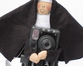 Nun doll Catholic gift photographer 'Sister Filmore'