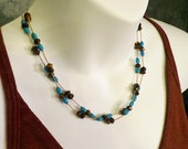 Turquoise and Tiger's Eye Necklace, Tin Cup Floating Necklace, Southwestern Style, Long, Gemstones on Silk, Blue and Brown, December Stone