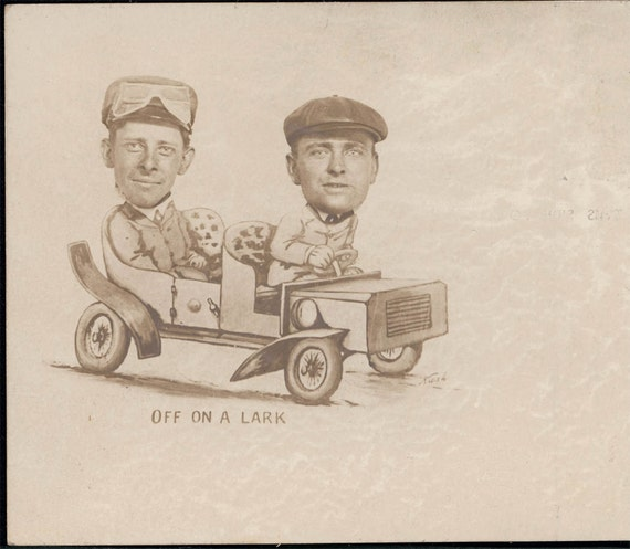 vintage photo unusual Amusement ARcade Two Men in Automobile wearing goggles and caps rppc