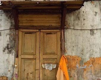 brown beige yellow orange photograph window orange jacket hanging wash Asia Chinatown