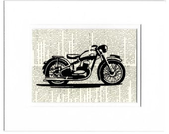 vintage motorcycle printed on page from old dictionary