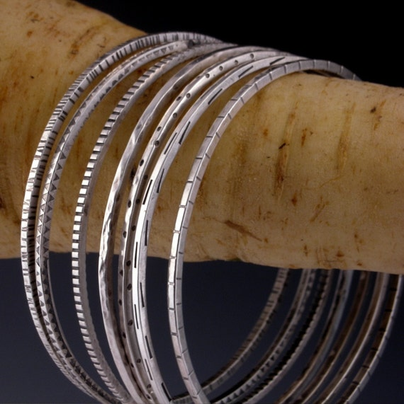 a gaggle of bangles  - a personally curated collection of bracelets in sterling silver