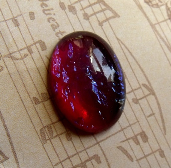 Mexican Opal or Dragons Breath Glass 25X18mm Oval One Cabochon