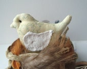 Small birdie in cotton with white linen wings