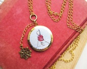 Pretty Round Art Locket -The girl with the six button red coat who hated skiing- I19