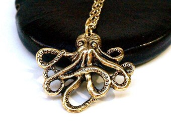 Small gold plated brass Octopus charm Necklace on a delicate gold plated chain