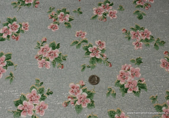 1930's Vintage Wallpaper Blue background with pink floral clusters