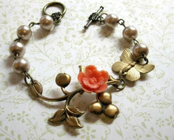 Brass Butterfly Bracelet, pearls with orange flower - brass charms