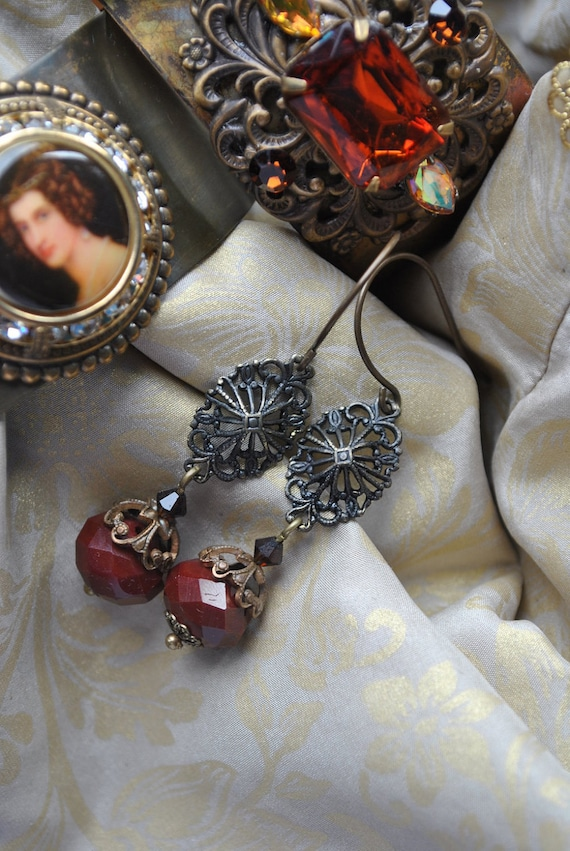 Antique style Maroon or oxblood red and antique brass filigree long dangle earrings.