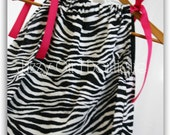 Pillowcase Dress Zebra Print with Fuschia Ribbon Ties.  Sizes 6 months to 5 years.  Sizes 6 through 8 Available for an Extra Charge.