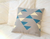 Decorative grey linen pillow cover with geometric tribal pattern