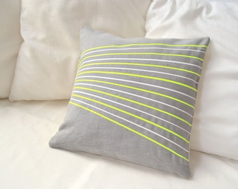 Linen pillow cover in silver gray with white and neon yellow stripes